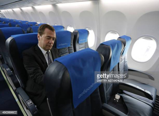 A picture taken at Moscow's Sheremetyevo airport on June 10 shows Russia's Prime Minister Dmitry Medvedev inspecting a passenger jet of Aeroflot's...