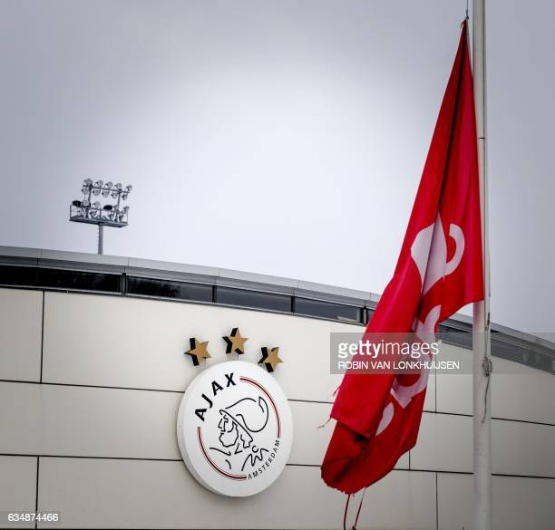 A picture taken at sports complex De Toekomst of Ajax Amsterdam football club in Amsterdam on February 12 shows dlags half mast in honor to the...