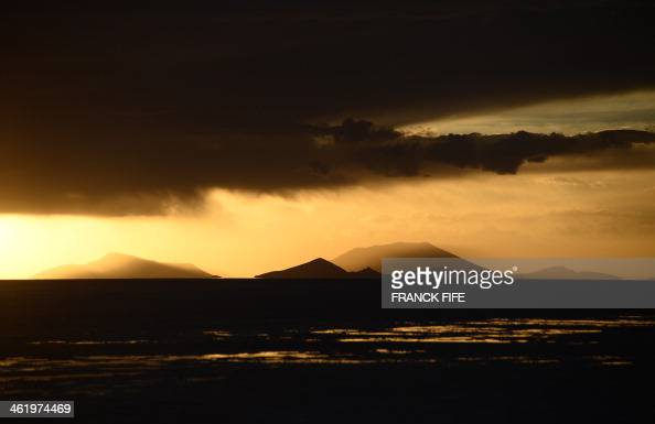 Picture taken at sunset at the Salar de Uyuni the world's largest salt flat located in Bolivia near the crest of the Andes some 3650 metres above sea...