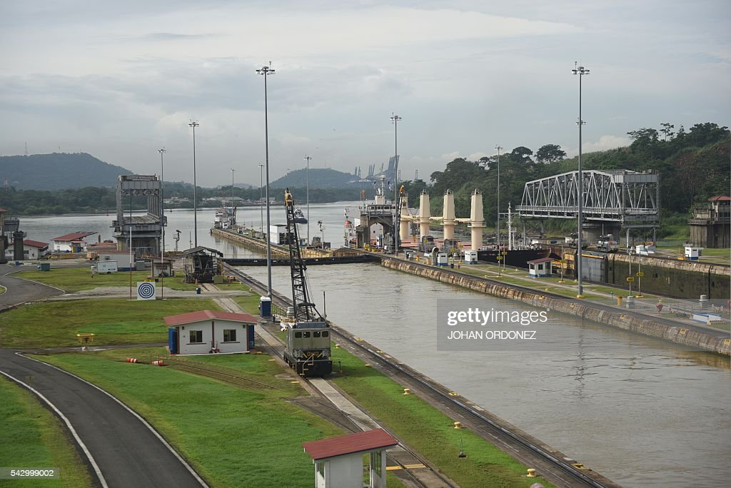 Picture taken at the Miraflores Locks of the Panama Canal, in Panama City on June 25, 2016. Panama will officially open its canal on Sunday to far bigger cargo ships after nearly a decade of expansion work aimed at boosting transit revenues and global trade. On Sunday, a VIP ceremony will be held on the banks of the canal to inaugurate the completion of the works. / AFP / JOHAN