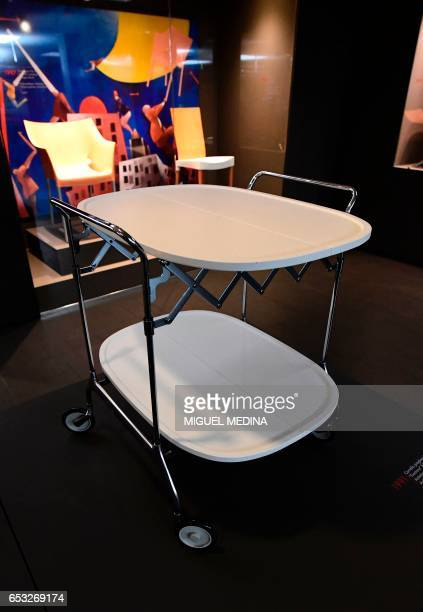 A picture taken at the museum of Italian contemporary furniture brand Kartell shows a 1991 'Gastone' foldable trolley designed by Italian designer...