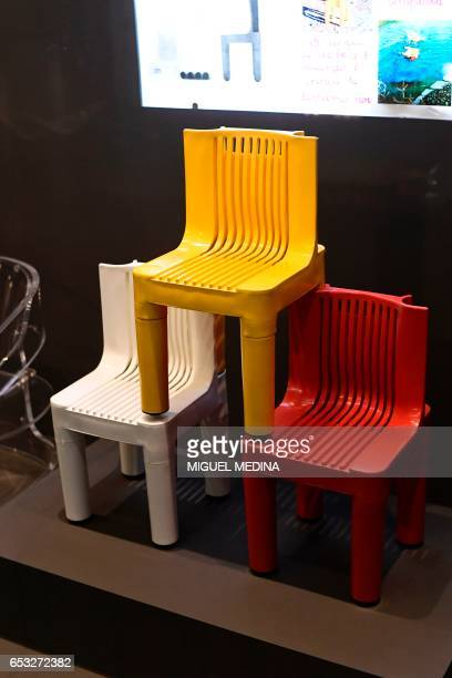 A picture taken at the museum of Italian contemporary furniture brand Kartell shows the first children chairs made entirely of plastic in 1964 by...