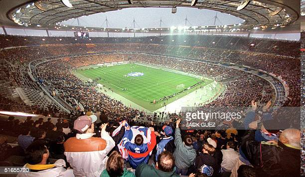 Picture taken at the Stade de France in SaintDenis north of Paris of fans cheering before the start of a Soccer World Cup match France will play...