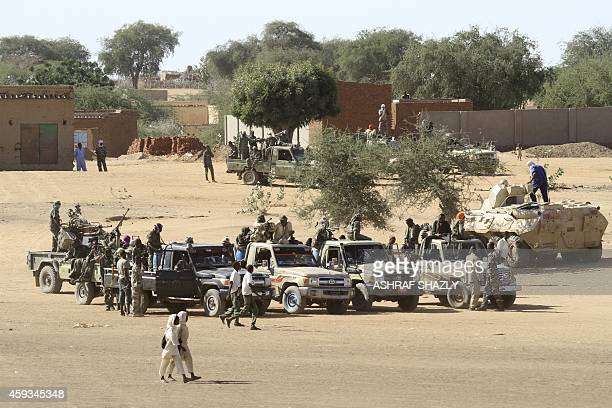 A picture taken during a government organised tour shows Sudanese troops standing guard in the village of Tabit in the North Darfur on November 20...