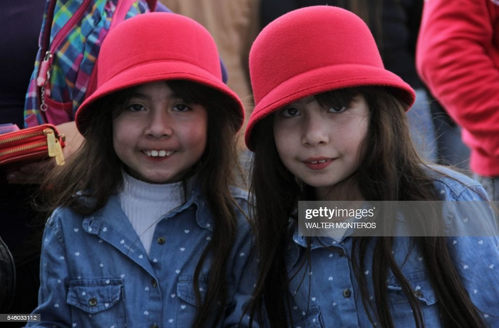 Picture taken during the 10th edition of the Twins Festival in Famailla Tucuman in northern Argentina on July 10 2016 / AFP / Walter Monteros