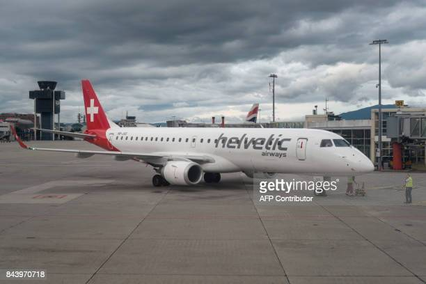 A picture taken early on September 6 2017 shows an Embraer ERJ190LR commercial plane model of the Zurich based Swiss airline Helvetic Airways at...