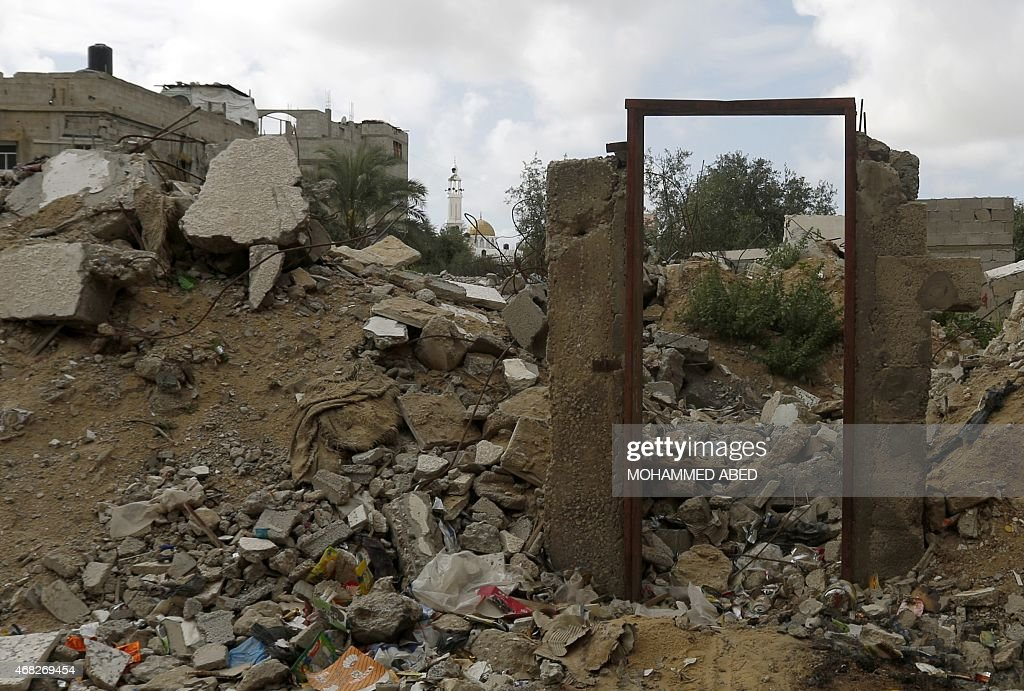 A picture taken east of Jabalia, in the northern Gaza Strip on April 1, 2015, shows a doorway that previously housed a mural of a weeping woman, said to have been painted by British street artist <a gi-track='captionPersonalityLinkClicked' href=/galleries/search?phrase=Banksy&family=editorial&specificpeople=157604 ng-click='$event.stopPropagation()'>Banksy</a>, in the rubble of a house that was destroyed during the 50-day war between Israel and Hamas militants in the summer of 2014. A Gazan man said he was tricked into selling the mural for a sum of 700 shekels ($180).