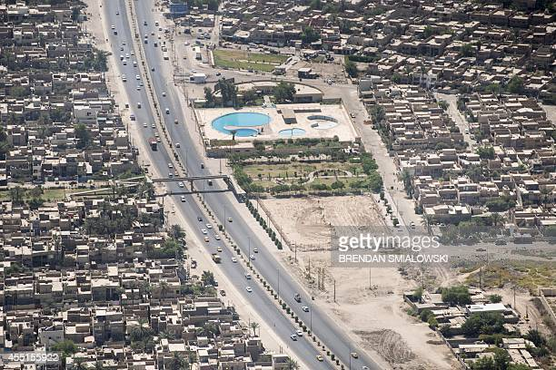 A picture taken from a helicopter on September 10 2014 shows an aerial view of Baghdad as US Sectary of State arrives in the Iraqi capital Kerry is...