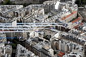 A picture taken from a helicopter shows Alphajet aircrafts from the French elite acrobatic flying team Patrouille de France releasing smoke in the...