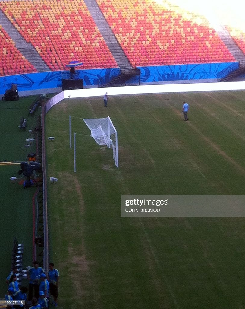 Picture taken from a smartphone from the Press tribune of Manaus stadium on June10 2014 showing the pitch of the Amazonia Arena. The pitch at Manaus's Amazonia Arena, on which England and Italy will play their opening World Cup game on June 14, was in a poor condition an AFP journalist remarked. The playing surface was noticeably dry and particularly bare around one of the goals, revealing large yellowing areas of turf.