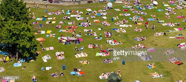 A picture taken from an Octocopter a remote controlled helicopter shows sunbathers lying in the grass next to De Tongelreep swimming pool in...