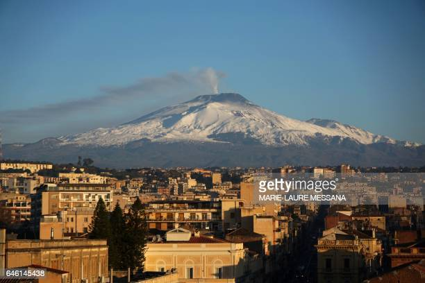 TOPSHOT A picture taken from Catania Sicily shows the Etna volcano covered with snow on February 16 2017 / AFP PHOTO / MarieLaure MESSANA