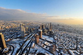 A picture taken from one of the highest buildings in Istanbul shows the city covered with snow on January 9 2013 after heavy snowfall blanketed...