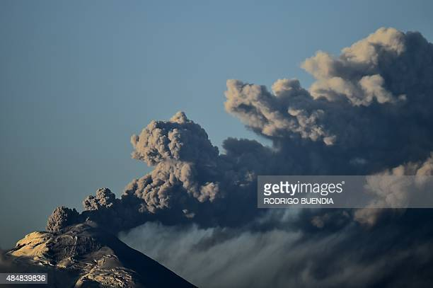 Picture taken from Quito of the Cotopaxi volcano spewing ash about 45 km south of Quito on August 22 2015 a week after it first started showing...