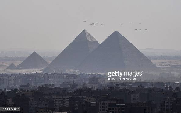 A picture taken from the 24th floor of a building in down town Cairo shows three French made Rafale fighter jets flying with other Egyptian air force...