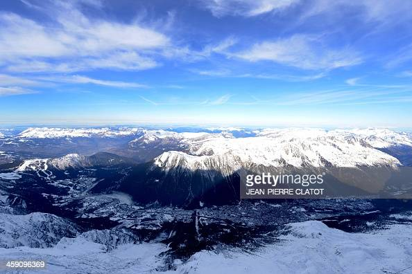 A picture taken from the Aiguille Du Midi peak shows the Chamonix valley on December 23 2013 AFP PHOTO / JEANPIERRE CLATOT