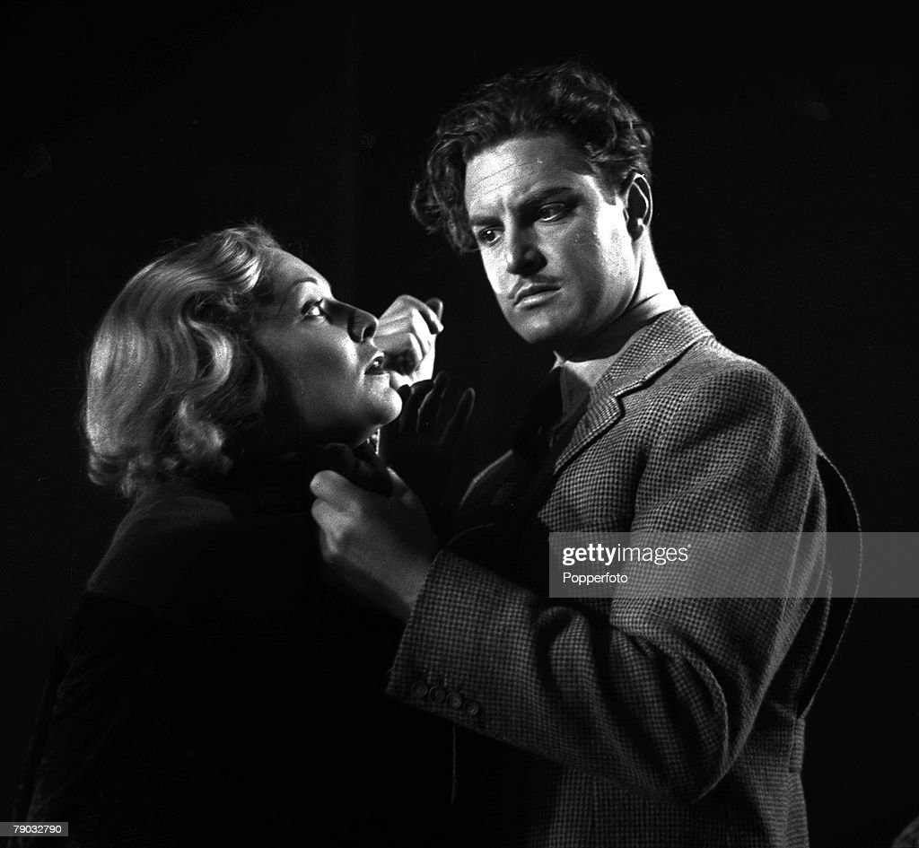 1935 A picture taken from the classic Alfred Hitchcock film 'The 39 Steps' In the scene pictured actor Robert Donat is seen grabbing actress...