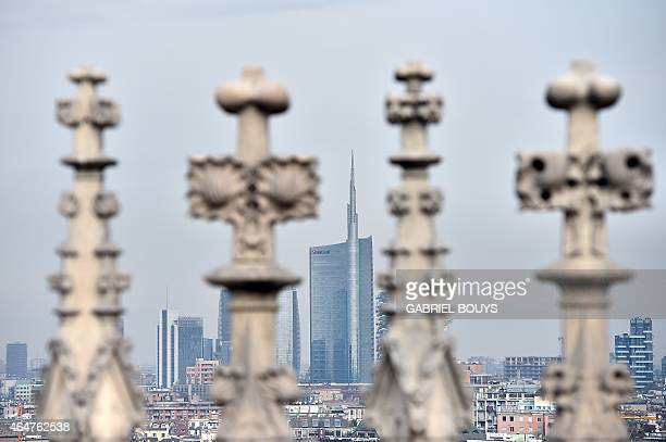 A picture taken from the Duomo of Milan shows new buildings in the business district of Porta Nuova on February 28 2015 Qatar's sovereign fund has...