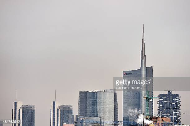 A picture taken from the Duomo of Milan shows new buildings in the business district of Porta Nuova with the Unicredit tower and the Bosco Verticale...