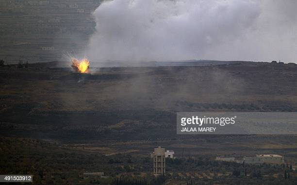 A picture taken from the hill village of Buqaata in the Israeliannexed Syrian Golan Heights shows flames and smoke ascending from alleged shelling by...