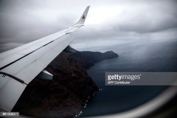 A picture taken from the inaugural first commercial flight between Johannesburg and Saint Helena shows the cliffs of the volcanic tropical island of...