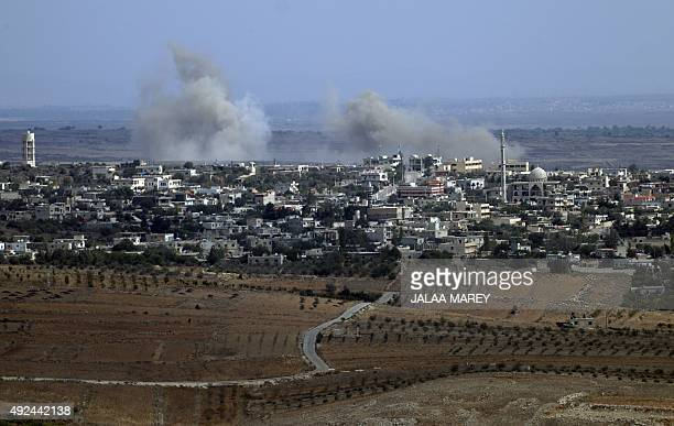 A picture taken from the Isaeliannexed Golan Heights shows smoke rising from the Syrian village of Jubata alKhashab after it was reportedly bombed by...