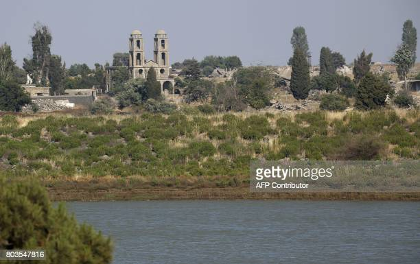 A picture taken from the Israeli side of the occupied Golan Heights shows a church destroyed during the 1967 war in the Syrian border town of...