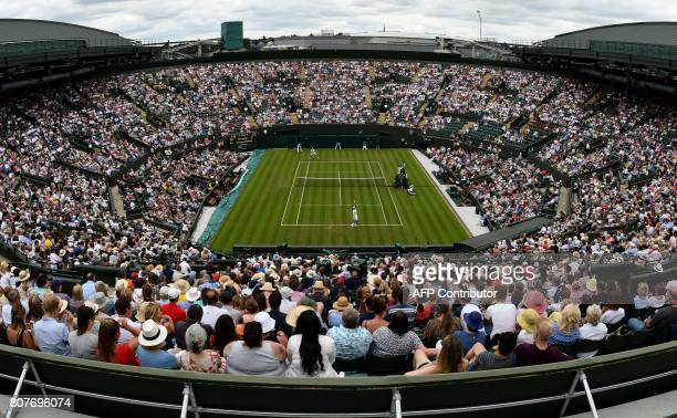 TOPSHOT A picture taken from the roof of No 1 court shows Canada's Milos Raonic play against Germany's JanLennard Struff during their men's singles...