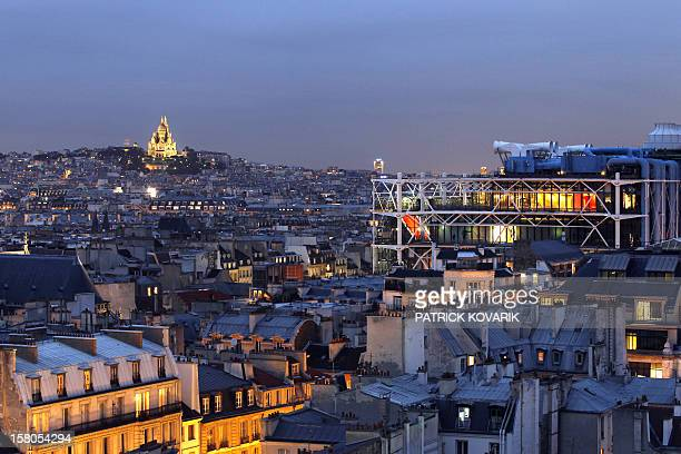 A picture taken from the roof of Paris' city hall on October 26 2010 shows the Centre Pompidou aka Beaubourg art center and the Sacre Coeur basilica...