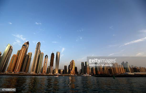 A picture taken from the sea on May 23 2015 shows skyscrapers in Dubai AFP PHOTO/MARWAN NAAMANI