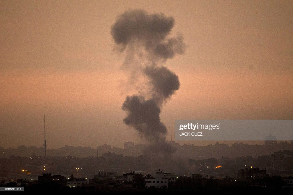A picture taken from the southern Israeli border with the Gaza Strip shows smoke billowing following an Israeli air strike inside the Palestinian territory on November 17, 2012. Turkish Prime Minister Recep Tayyip Erdogan said that Israel would be held to account for the children among 40 people dead in three days of air strikes on Gaza. AFP PHOTO / JACK GUEZ