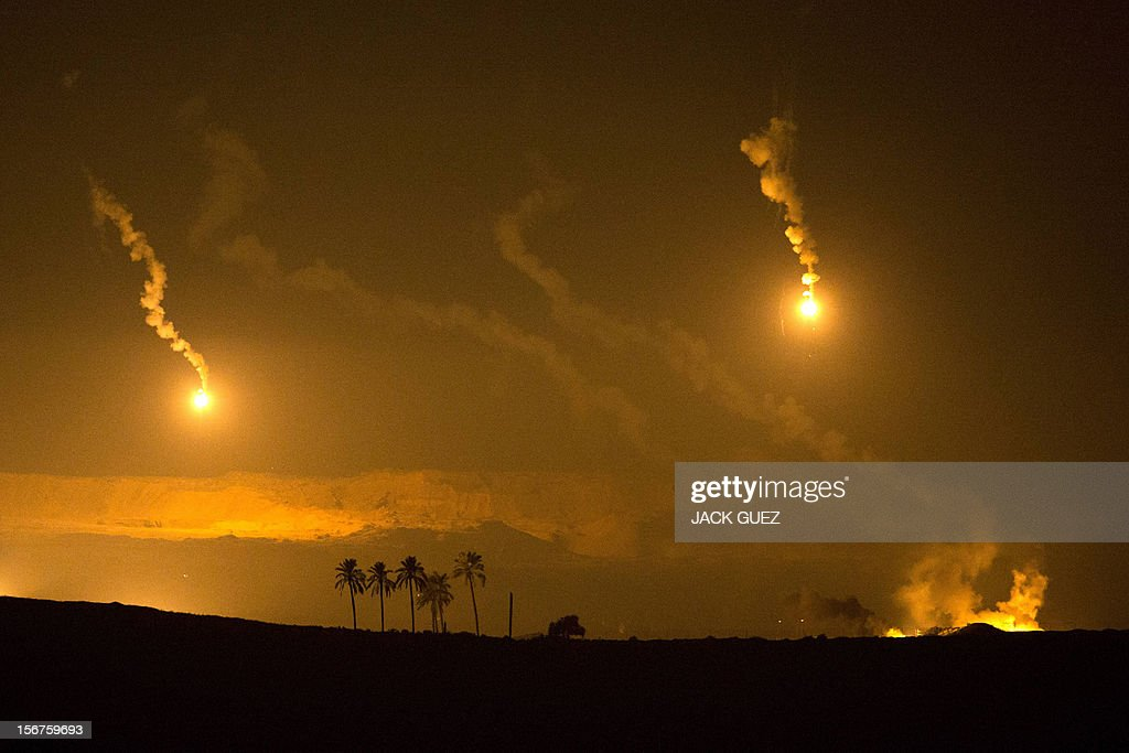 A picture taken from the southern Israeli border with the Gaza Strip shows Israeli artillery flares illuminating the Palestinian coastal enclave on November 20, 2012. Gaza militants said a Cairo-brokered truce in their seven-day war with Israel would be announced, as Israeli Prime Minister Benjamin Netanyahu urged them to choose between 'the sword' and peace. AFP PHOTO/JACK GUEZ