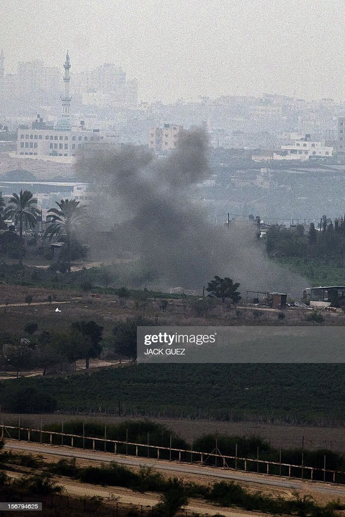 A picture taken from the southern Israeli border with the Gaza Strip shows smoke billowing following an Israeli air strike inside the Palestinian territory on November 21, 2012. UN Secretary General Ban Ki-moon arrived in Cairo for talks with President Mohamed Morsi, the Egyptian leader's office said, amid efforts to broker a truce in Gaza. AFP PHOTO / JACK GUEZ