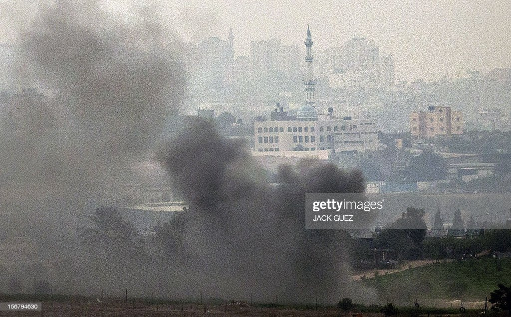 A picture taken from the southern Israeli border with the Gaza Strip shows smoke billowing following an Israeli air strike inside the Palestinian territory on November 21, 2012. UN Secretary General Ban Ki-moon arrived in Cairo for talks with President Mohamed Morsi, the Egyptian leader's office said, amid efforts to broker a truce in Gaza.