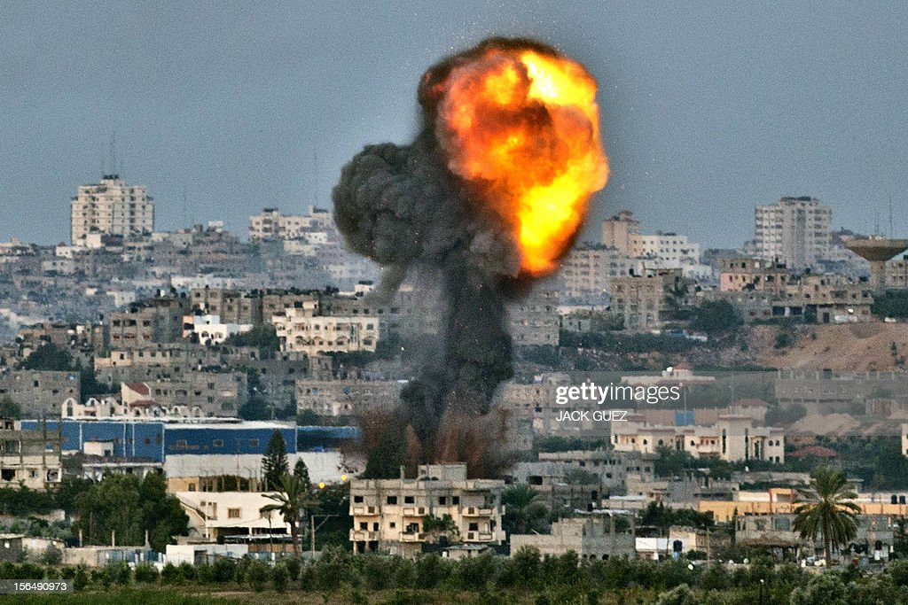 A picture taken from the southern Israeli Gaza border shows smoke billowing from a spot targeted by an Israeli air strike inside the Gaza strip on...