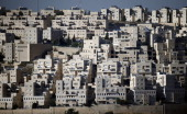 A picture taken from the West Bank Town of Bethlehem on May 14 2014 shows a part of the Israeli settlement of Har Homa AFP PHOTO / THOMAS COEX