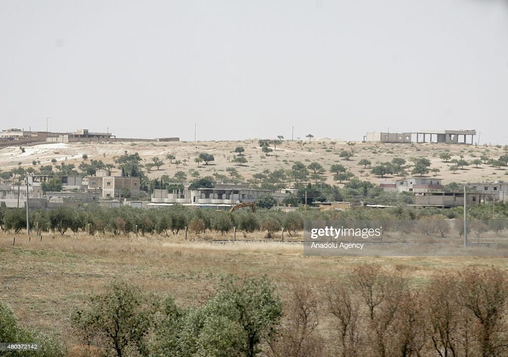 A picture taken from Turkey's Gaziantep province which has border with Jarabulus district of Syria's Aleppo province shows Daesh militants dig giant...