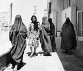 Picture taken in 1962 of Afghan women passing by a street in Kabul As four of them are dressed in a complete headtotoe garment with a mesh covered...