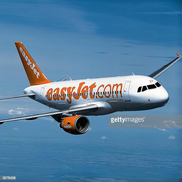 Picture taken in 2004 in Germany's air space shows the EADSmade medium range airliner Airbus' A319 for British lowcost EasyJet company The...