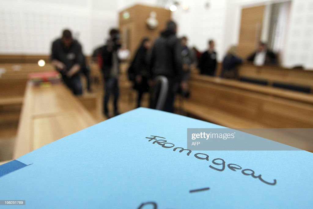 A picture taken in a courtroom on November 12, 2012 in Ajaccio shows a folder prior to the start of the trial of 19-year-old boy for shooting dead his parents and 10-year-old twin brothers in 2009. The accused, named as Andy Fromageau, exterminated the entire family in August 2009 with his father's Winchester rifle in an act he said occurred in a trance-like state.