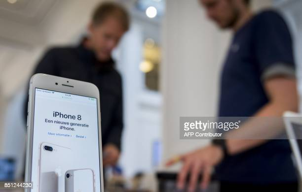 A picture taken in an Apple Store in Amsterdam on September 22 2017 shows an iPhone 8 Apple releases its new iPhone 8 and iPhone 8 Plus and the new...