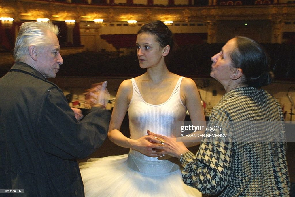 A picture taken in Bolshoi Theatre in Moscow on February 20, 2001, shows great Russian choreographer Yuri Grigorovich (L) and legendary Russian ballerina Natalya Besmertnova (R) giving instructions to dancer Galina Stepanenko (C), as Odette,during the rehearsal of Pyotr Chaikovsky's 'Swans' Lake'. Russia's Bolshoi ballet appointed today Galina Stepanenko, one of its most experienced ballerinas, as its acting chief after last week's horrific acid attack on the theatre's artistic director Sergei Filin.