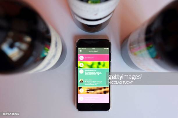 A picture taken in Bordeaux on January 28 shows a smartphone running the mobile app 'Winewoo' developed by Bordeauxbased startup Kasual business...