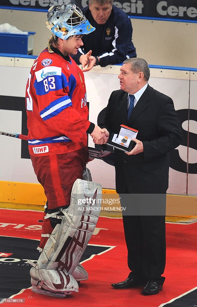 A picture taken in Cologne on May 22, 2010 shows Soviet ice hockey great Vladimir Krutov (R) awarding Russian goalkeeper Vassily Koshechkin an MVP prize for the semi-final match of the IIHF International Ice Hockey World Championship between Germany and Russia. Former Soviet ice hockey great Vladimir Krutov, a two-time Olympic Games winner and repeated world champion, has died in a Moscow hospital, the Russian ice hockey federation reported on June 6, 2012. On June 3, 2012, Krutov, 52, was rushed into intensive care with an internal haemorrhage with medics failing to save him.
