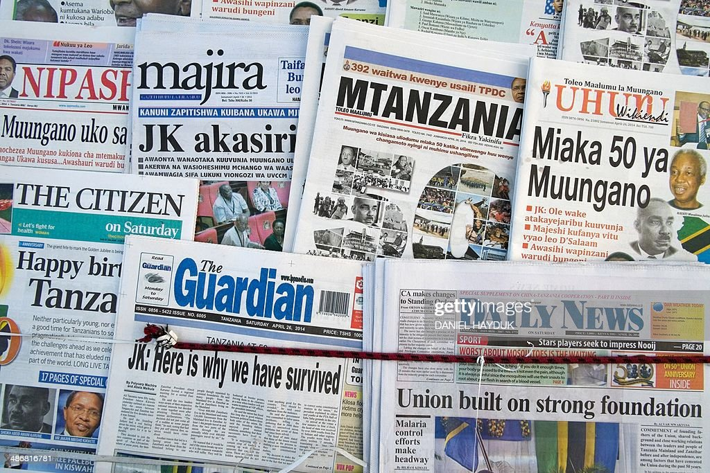 A picture taken in Dar es Salaam on April 26, 2014 shows frontpages of Tanzanian newspapers which anounce the 50th anniversary of the Union Day in Tanzania, which celebrates the union of Zanzibar and Tanganyikain,. AFP PHOTO Daniel Hayduk