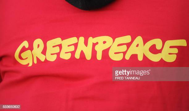 A picture taken in Douarnenez western France on May 23 2016 shows the logo of the nongovernmental environmental organization Greenpeace on the jersey...