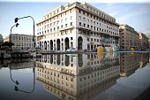 A picture taken in downtown Genoa on October 11 2014 shows a flooded street a day after one person died when flood waters swept through the city...