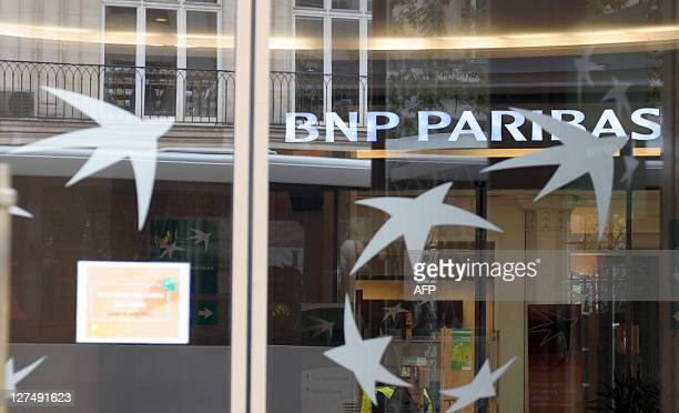Picture taken in front of an agency of French bank BNP Paribas in Paris on August 11 2011The Paris stock market fell 123 percent in midday trade on...