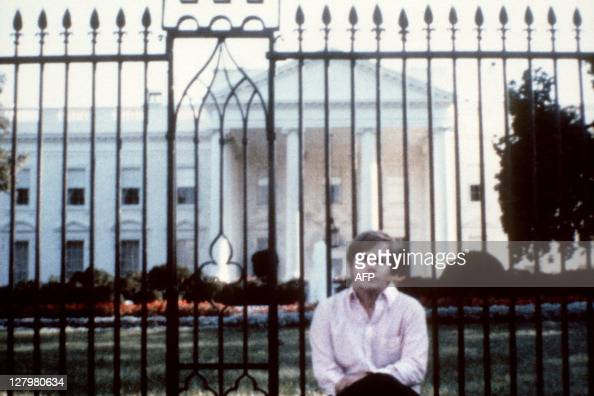 Picture taken in front of the White House of John Hinckley who attempted to assassinate US President Ronald Reagan in Washington DC on March 30 as...