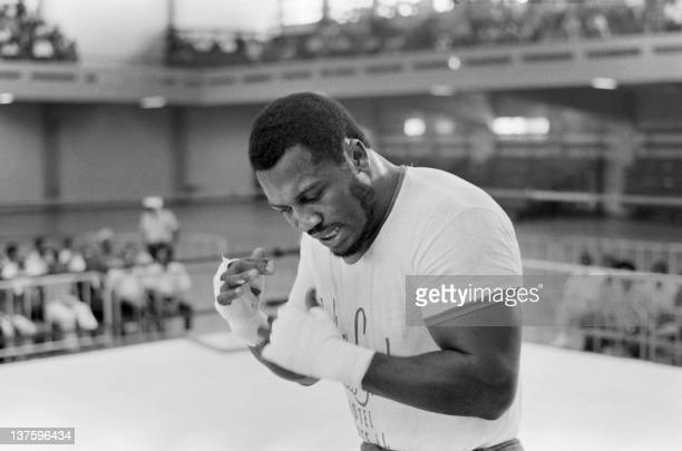 A picture taken in January 1973 of US heavyweight boxing champion Joe Frazier during a training in Kingston before his match against George...